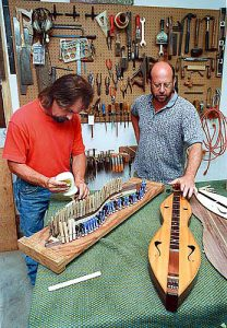 7-12-98 Joe Crocetta  -- Gary Munson, left, is an apprentice under luthier Don Kawalek and is learning to make dulcimers and guitars in Kawaleks Bunker Hill shop.
